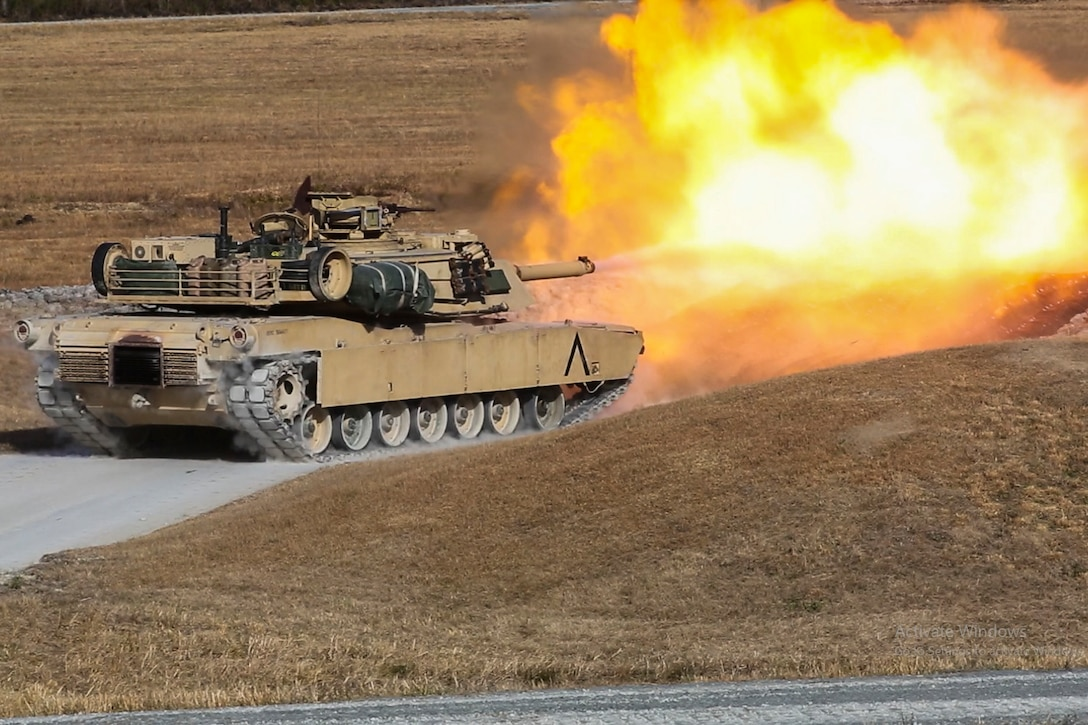 A tank fires its main gun.