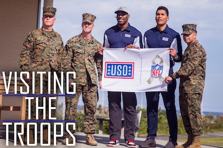 NFL alumni Donnie Edwards, center right, and Steven Jackson, center, visited Marines and Sailors Feb. 3, 2019, at the USO on Camp Kinser, Okinawa, Japan. The USO invited Edwards and Jackson to tour the military installations on Okinawa, Japan in order to visit service members and boost morale during the height of the football season. (U.S. Marine Corps photo by Lance Cpl. Mark Fike)
