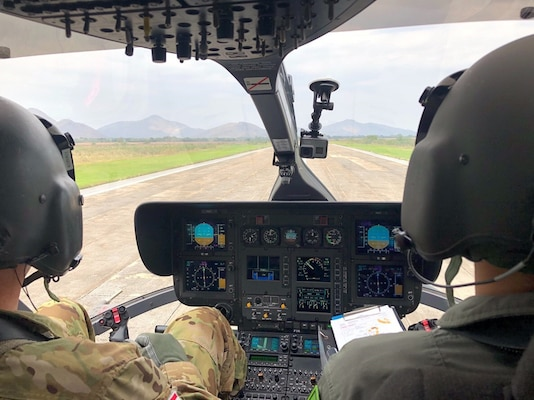 "Chief Warrant Officer 5 Jay Enders, Charlie Co. 1st Battalion, 112th Aviation conducts a test flight in a LH-72 ""Lakota"" with his Thai counterpart on January 17, at the Royal Thai Army Aviation base in Lop Buri, Thailand."