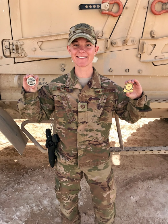 Tech. Sgt. Dawn Gettys, 445th Security Forces Squadron, shows off coins she received for the support she provided during the presidential visit to Al Asad Air Base, Iraq. Gettys was the command and control lead for the presidential motorcade during U.S. President Donald Trump and first lady Melania Trump's visit, December of 2018.  She worked directly with the Secret Service and Naval Special Warfare Seal Team to plan the visit. (Courtesy photo)