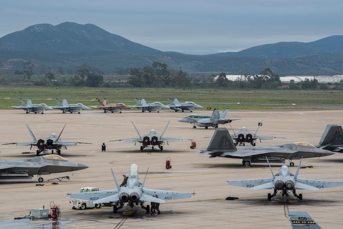 Various aircraft stay positioned on the flightline during joint exercise Winter Fury at Marine Air Station Miramar, San Diego, Calif., Jan. 17, 2019. Winter Fury involved both Marine F/A-18C Hornets, and Navy F-35C Lightning II's, partnering with Air Force F-22 Raptors to perform air-to-air combat, while protecting ground assets. (U.S. Air Force photo by Airman 1st Class Caitlin Russell)