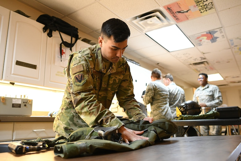 388th Operations Support Squadron Aircrew Flight Equipment shop, works on flight equipment, Nellis Air Force Base, Nevada, Feb. 5, 2019. AFE Airmen manage, check and prepare gear pilots need to fly and also survive in the event of an emergency. (U.S. Air Force photo by R. Nial Bradshaw)