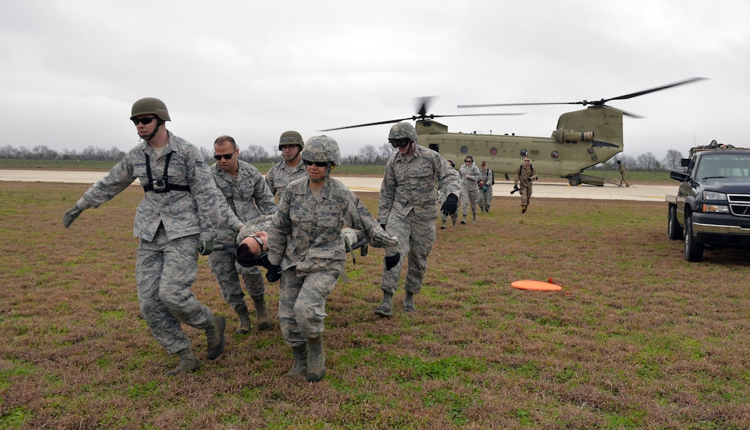 A 433rd Airlift Wing Reserve Citizen Airmen medical team carries a simulated patient away from an idling Texas Army National Guard CH-47 Chinook during Operation Dust Storm Feb. 1, 2019 at Martindale Army Air Field, Texas.