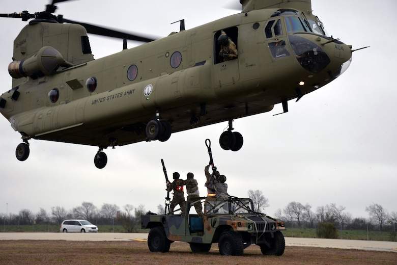 A ground crew prepares to hook a Humvee to a Texas Army National Guard CH-47 Chinook for airlifting during Operation Dust Storm at Martindale Army Air Field, Texas Feb. 1, 2019.