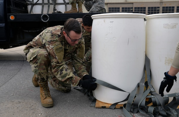 Joint, total-force Operation Dust Storm team members Tech Sgt. Charles Cate, 26th Aerial Port Squadron loadplanner, and Airman 1st Class Ernesto Contreras III, 74th APS air transportation specialist, build-up the sling-load package Feb. 1, 2019 at Martindale Army Air Field, Texas.