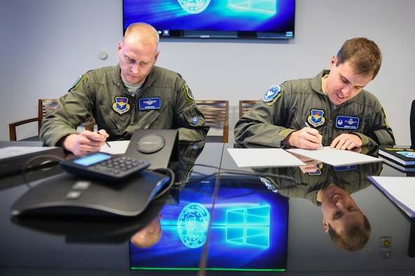 U.S. Air Force Lt. Col. Darin Dial, 56th Air Refueling Squadron director of operations, and Lt. Col. Brent Toth, 56th ARS commander, sign the first set of flight orders for the incoming KC-46A Pegasus, Feb. 4, 2019, at Altus Air Force Base, Okla. The 56th ARS will conduct training for the pilots and boom operators of the KC-46. (U.S. Air Force photo by Airman 1st Class Jeremy Wentworth)