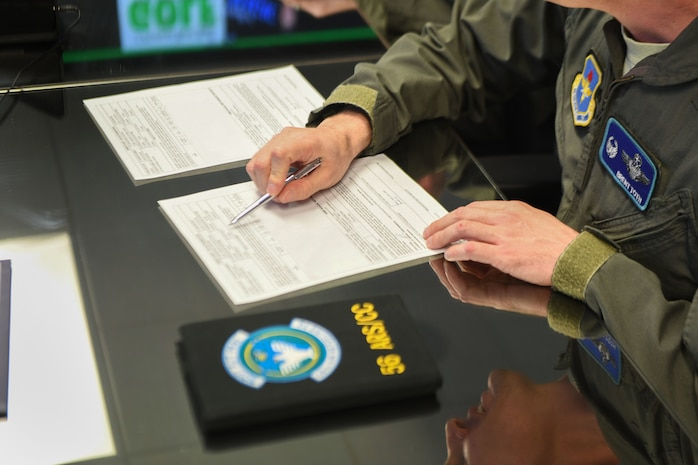 U.S. Air Force Lt. Col. Brent Toth, 56th Air Refueling Squadron commander, signs the first set of flight orders for the incoming KC-46A Pegasus, Feb. 4, 2019, at Altus Air Force Base, Okla. The flight orders are for the crew that will be flying the KC-46 from Washington State to Altus AFB. (U.S. Air Force photo by Airman 1st Class Jeremy Wentworth)