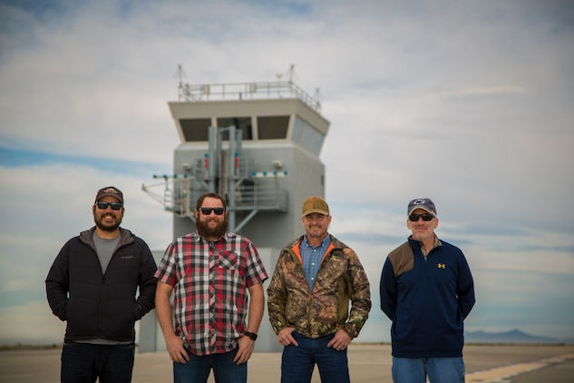 Personnel with the Conservation, Natural Resource section of Range Management, Marine Corps Air Station (MCAS) Yuma, pose for portrait photographs on ranges owned by MCAS Yuma, Jan. 17, 2019. The Conservation staff is responsible for all areas of wildlife management and recreation on all 1.2 million acreas of MCAS Yuma ranges. (U.S. Marine Corps photo by Sgt. Allison Lotz)