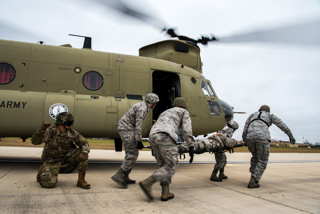 Airmen from the 433rd Medical Group perform a litter carry from a CH-47 Chinook assigned to the Texas Army National Guard, during a training exercise at Martindale Army Airfield, San Antonio, TX, Feb 1, 2019.