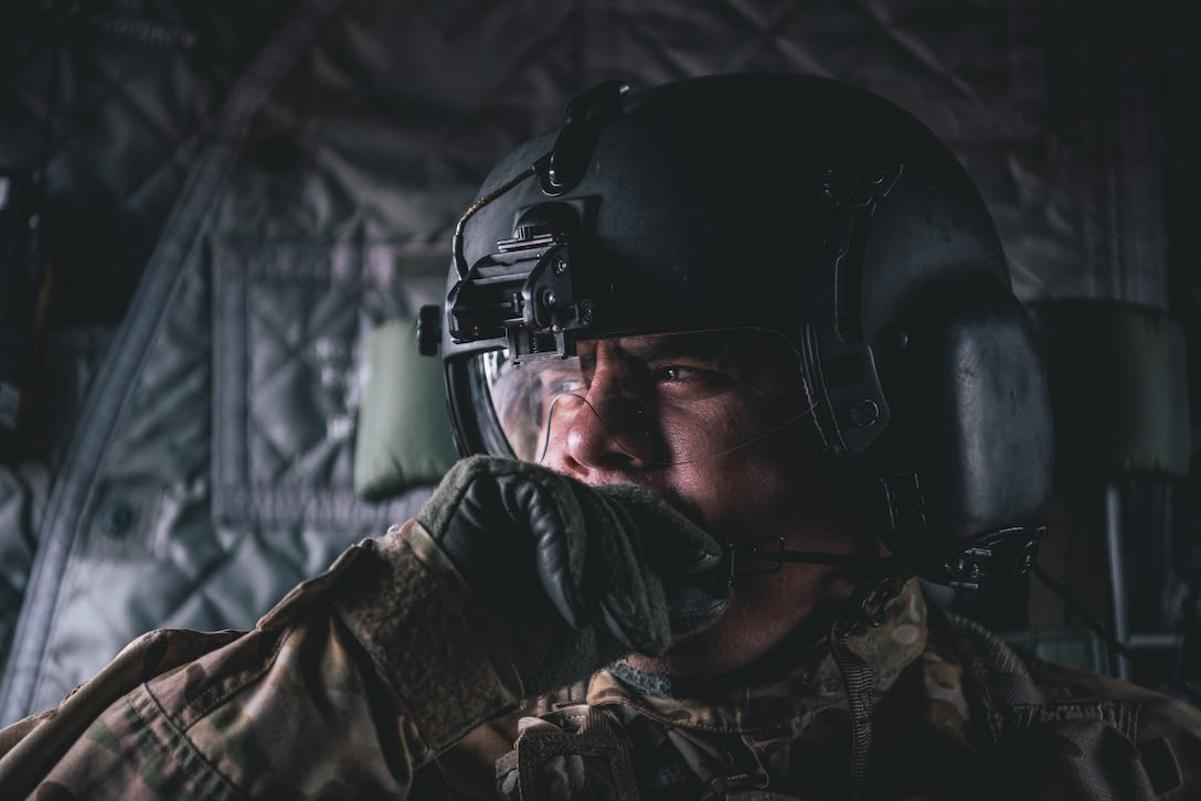 Sergeant Manuel Acevedo uses his headset to communicate with additional aircrew members of a CH-47 Chinook helicopter at Kelly Field Annex, San Antonio, TX, Feb 1, 2019.