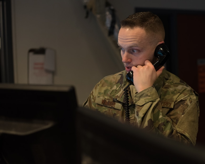 U.S. Air Force Staff Sgt. Gabriel Walker, 60th Maintenance Group Maintenance Operations Center senior maintenance controller, coordinates with higher headquarters to send a maintenance recovery team to Joint Base Pearl Harbor-Hickam, Hawaii, Jan. 25, 2019 at Travis Air Force Base, Calif. The MOC coordinates maintenance actions for all aircraft at Travis and Travis aircraft flying missions all over the world. (U.S. Air Force photo by Tech. Sgt. James Hodgman)