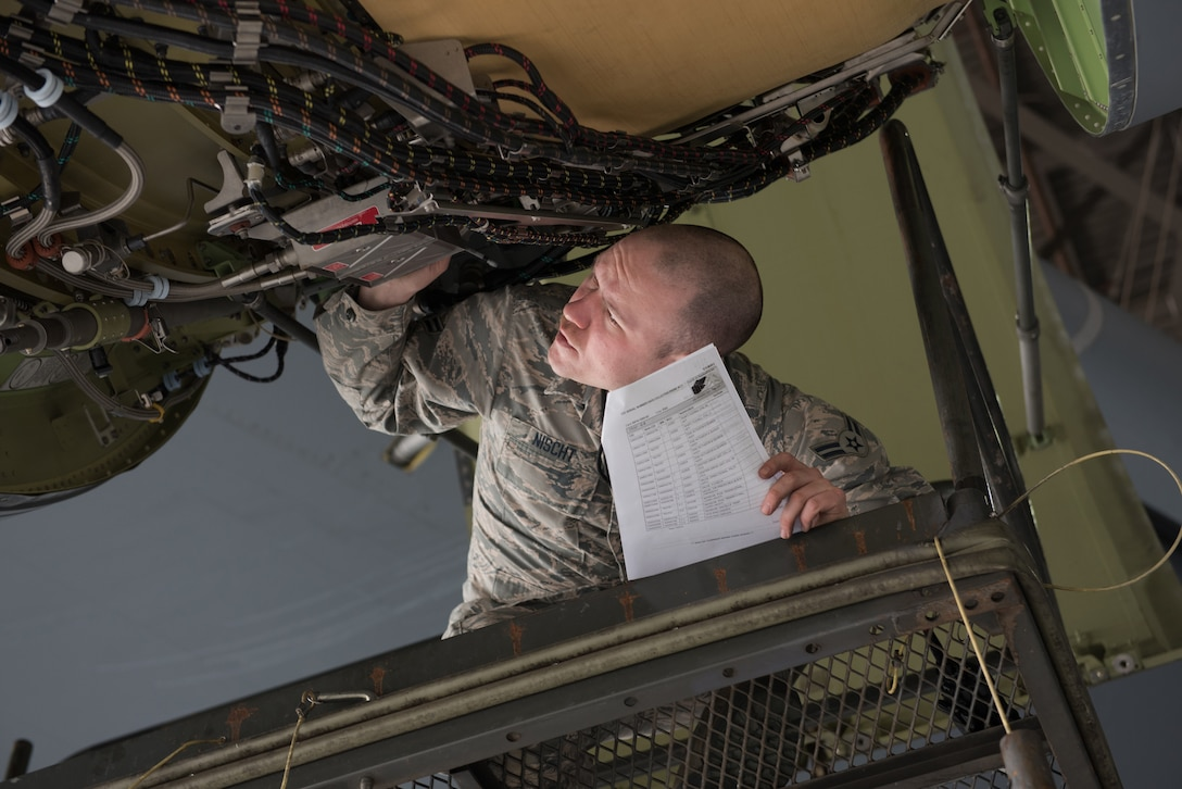 U.S. Air Force Airman 1st Class Kyle Nischt, 60th Aircraft Maintenance Squadron aerospace propulsion journeyman, inspects a C-5M Super Galaxy Jan. 28, 2019 at Travis Air Force Base, Calif. Regular maintenance ensures the C-5 is mission ready and the 60th Maintenance Group's Maintenance Operations Center coordinates all maintenance actions at Travis. (U.S. Air Force photo by Tech. Sgt. James Hodgman)