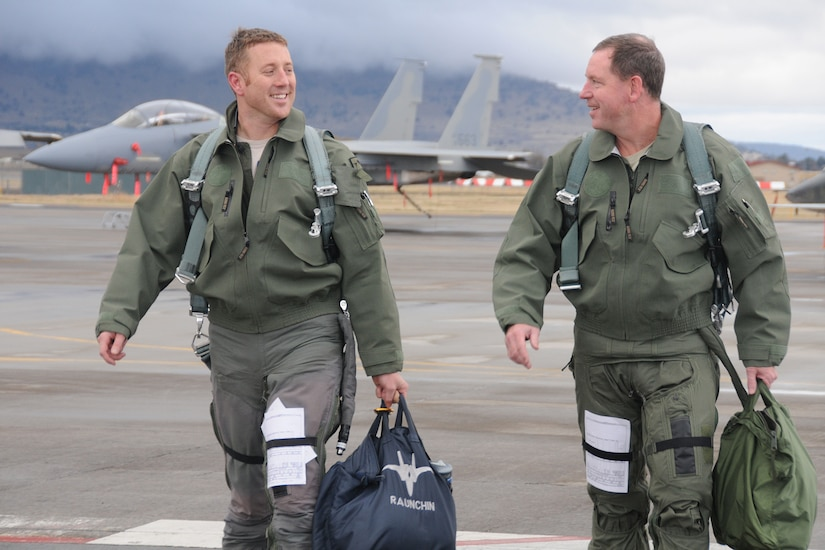 Two men walk on flight line