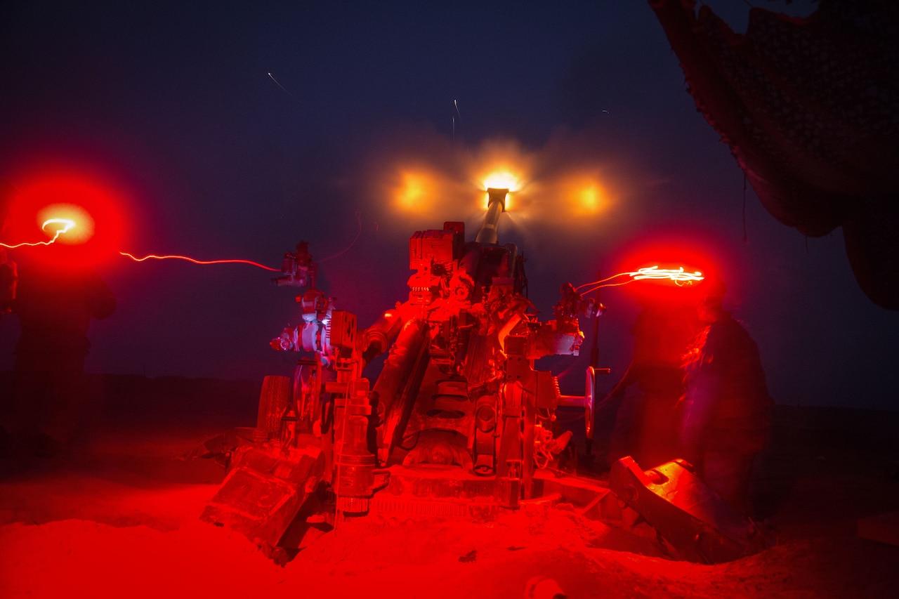 Artillery piece fires at night