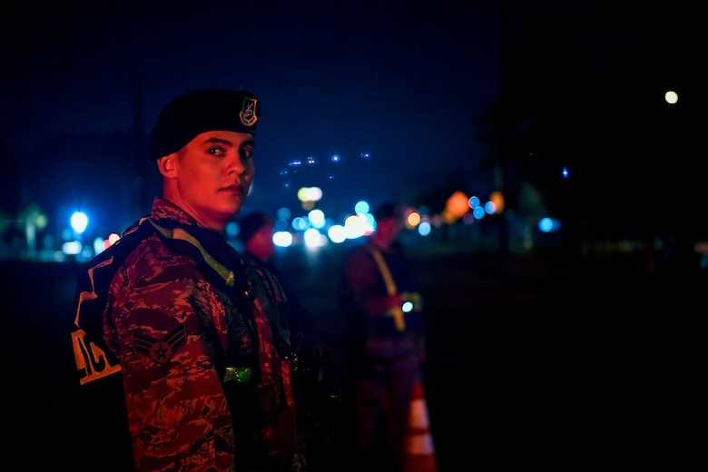 Senior Airman Joe Serna, 628th Security Forces Squadron patrolman, waits for a car during a DUI checkpoint Feb. 3, 2019, at Joint Base Charleston, S.C.