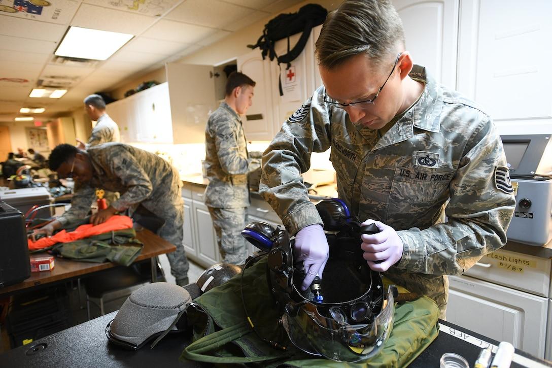 Tech. Sgt. Anthony Farnsworth works on flight equipment