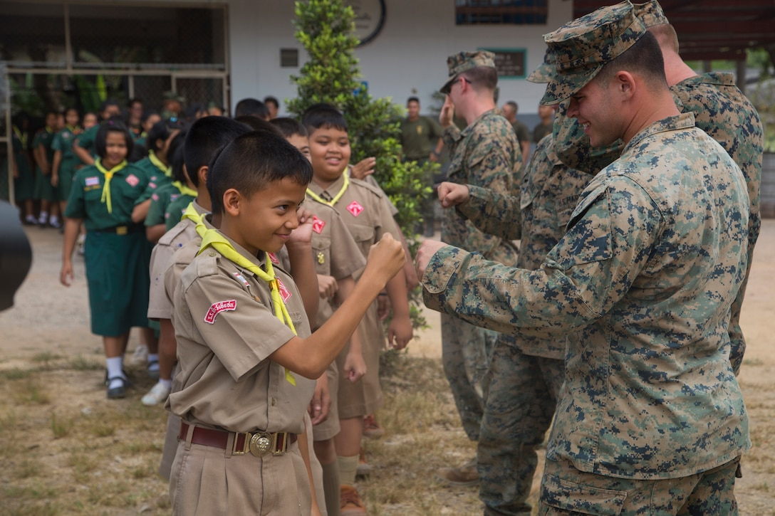 Marines greet a group of students.