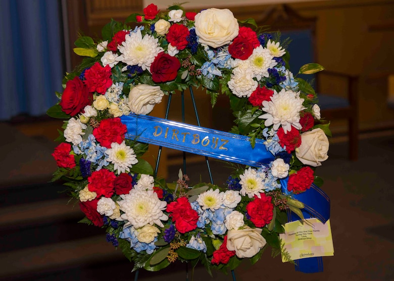 "A wreath from the ""Dirt Boyz"" of the 633rd Civil Engineer Squadron sits on display at Bethel Chapel during the funeral service of U.S. Air Force Tech. Sgt. Jason Kelley, 633rd CES NCO in charge of pavements and equipment at Joint Base Langley-Eustis, Virginia, Jan. 21, 2019,. Kelley, who was part of the Dirt Boyz, passed away after a two-year battle with stage four esophageal cancer. (U.S. Air Force photo by Airman 1st Class Marcus M. Bullock)"