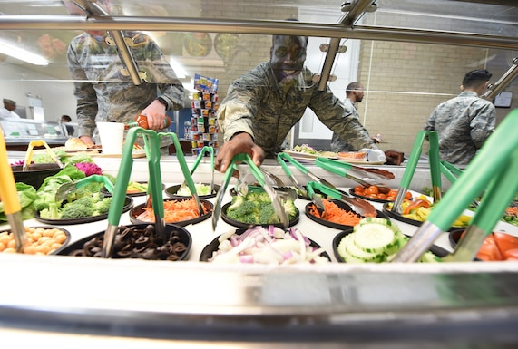 Airman making a salad