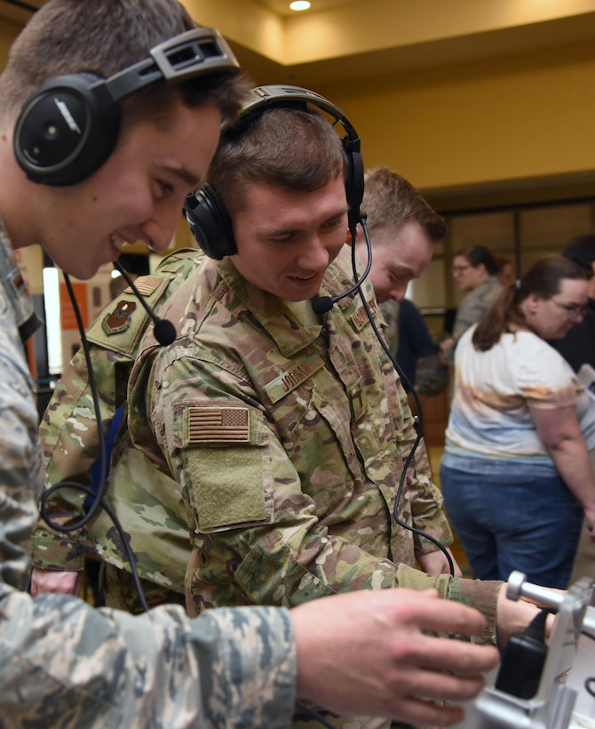 U.S. Air Force 2nd Lts. Steven Call and Taylor Jordan, 333rd Training Squadron students, test out Bose aviation headsets during the Annual Keesler Air Force Base Tech Expo inside the Bay Breeze Event Center at Keesler Air Force Base, Mississippi, Feb. 5, 2019. The expo was hosted by the 81st Communications Squadron and was free to all Defense Department, government and contractor personnel with base access. U.S. Air Force Maj. Jon Drummond, 81st CS commander, said events like this allows us to see the local vendors' newest technologies and find opportunities to branch that technology with Keesler's training mission. The event was held to introduce military members to the latest in technological advancements to bolster the Air Force's capabilities in national defense. (U.S. Air Force photo by Kemberly Groue)