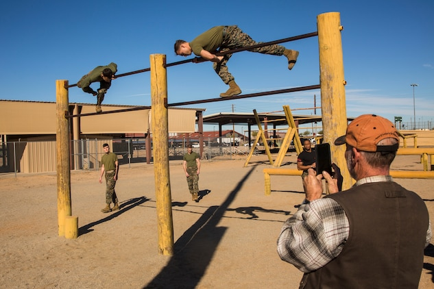 Guests participating in the Marine Corps Air Station (MCAS) Yuma Winter Tours observe a demonstration of the obstacle course, the Marine Corps Martial Arts Program (MCMAP), and a military working dog demonstration at various locations on MCAS Yuma, Ariz., Jan.9, 2019. Col. David A. Suggs, the station commanding officer, resumed the tours in 2018 to strengthen the relationship with the outside community and give them the opportunity to see what the Marines aboard the air station do. (U.S. Marine Corps photo taken by Cpl. Isaac D. Martinez)