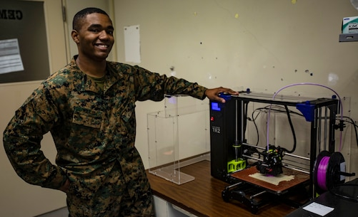 U.S. Marine Corps Sgt. Adrian J. Willis, a computer technician with 7th Communications Battalion, pictured here aboard Marine Corps Base Camp Hansen in Okinawa, Japan, is one of the Marines that utilize 3D printing technology to expand capabilities within the unit.