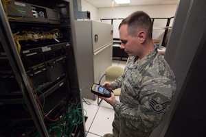 Staff Sgt. Daniel McGowan, 747th Communications Squadron network infrastructure specialist, tests a port network connection on Joint Base Pearl Harbor-Hickam, Hawaii, Feb. 6, 2019. The 747th CS, maintains the NIPR and SIPR networks for the 15th Wing, allowing Airmen to execute their missions across the Indo-Pacific region. (U.S. Air Force photo by Tech. Sgt. Heather Redman)
