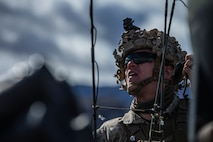 A U.S. Marine with 1st Battalion, 7th Marine Regiment, Marine Air-Ground Task Force-6 shouts emeny coordinates while participating in the Regimental Assault Course during Integrated Training Exercise 2-19 at Marine Corps Air-Ground Combat Center Twentynine Palms, Calif., Feb. 4, 2019. ITX creates a challenging, realistic training environment that produces combat-ready forces capable of operating as an integrated MAGTF.