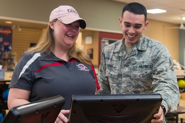 Gerri Fischer, 47th Force Support Squadron bowling alley manager, shows off a touchpad panel to Airman 1st Class Lucas Lobo, 47th Medical Group unit deployment manager, at Laughlin Air Force Base, Texas, Feb. 6, 2019. In a bid to update the bowling game for the newest generation, the 47th Force Support Squadron recently completed upgrades to the Cactus Lanes bowling alley. The changes involve not only a modernization, but personalized and new ways to play the game.