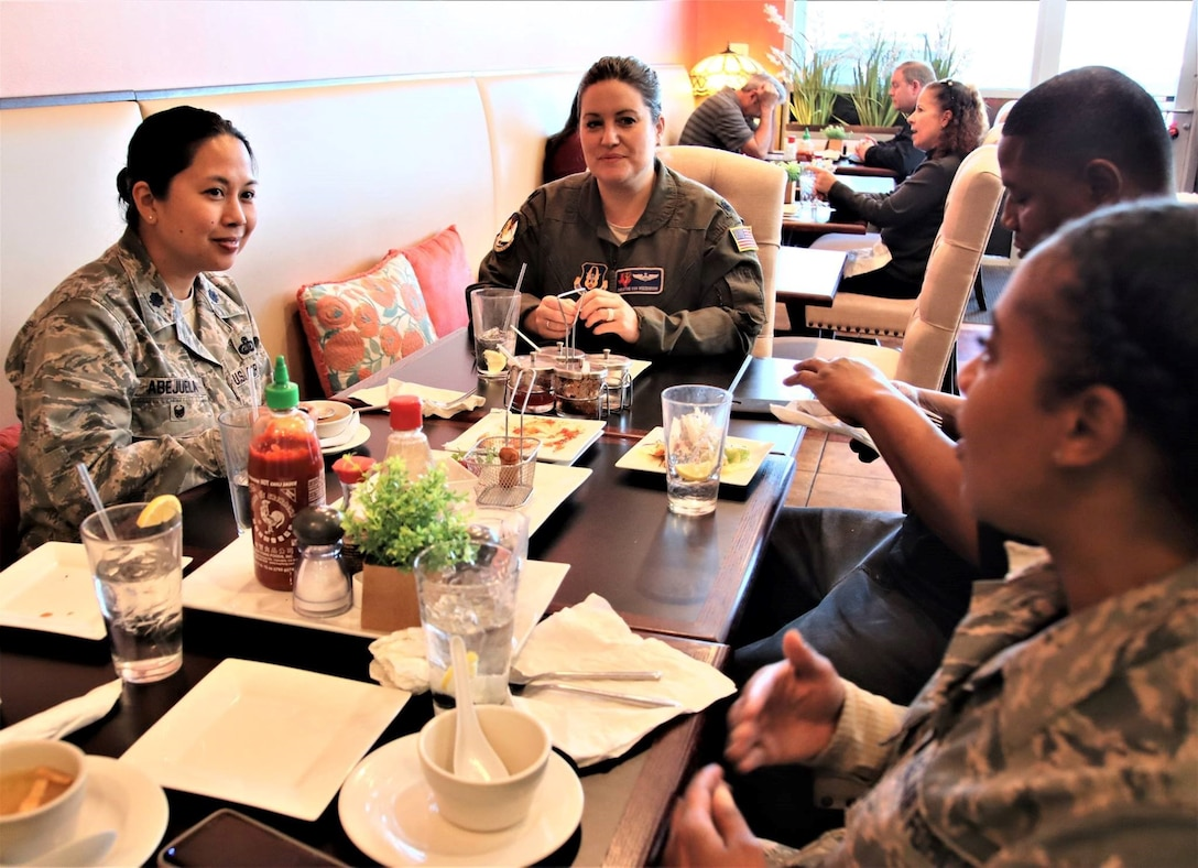 Lt. Col. Myla Abejuela (left), 340th FTG inspector general for the last two and a half years, chats with group members Jan. 23 during one of several lunch gatherings held to say goodbye and wish her well in her new job as individual mobilization augmentee to the 436th Force Support Squadron commander, Dover, AFB. The move was a bit of a homecoming for Abejuela whose last active duty unit was at the 436th. (U.S. Air Force photo by Janis El Shabazz)