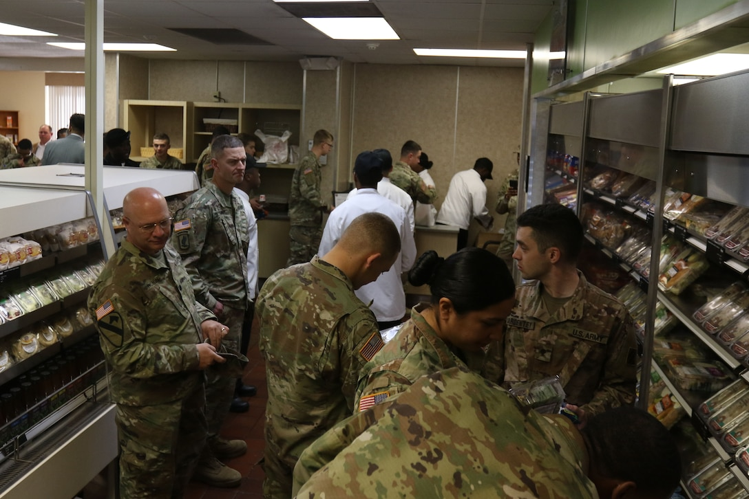 Soldiers with the 3rd Infantry Division shop at the Culinary Outpost Kiosk, Feb. 4, 2019 at Ft. Stewart, Ga. The food kiosk, first of its kind for the DLA and the Army, symbolizes the innovation and modernization efforts of the Army's food program. (U.S. Army photo by Sgt. Elizabeth White/Released)