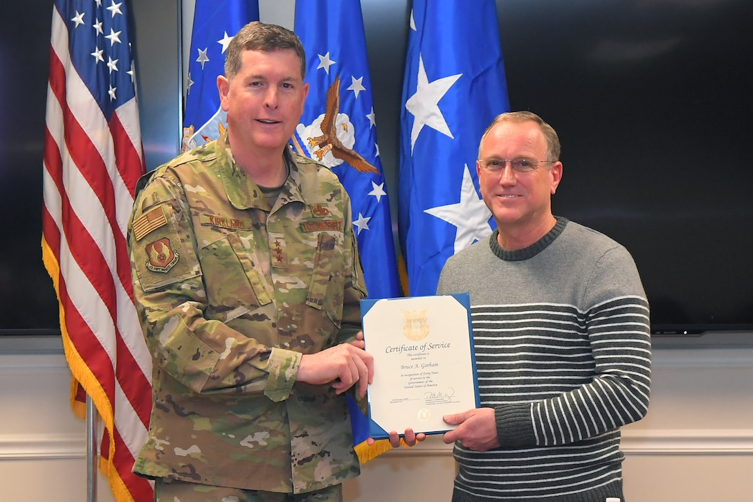 Bruce A. Gorham, 532nd Commodities Maintenance Squadron, receives a 40-year certificate of service from Lt. Gen Gene Kirkland, Air Force Sustainment Center commander, Feb. 4, 2019, at Hill Air Force Base, Utah. (U.S. Air Force photo by Todd Cromar)