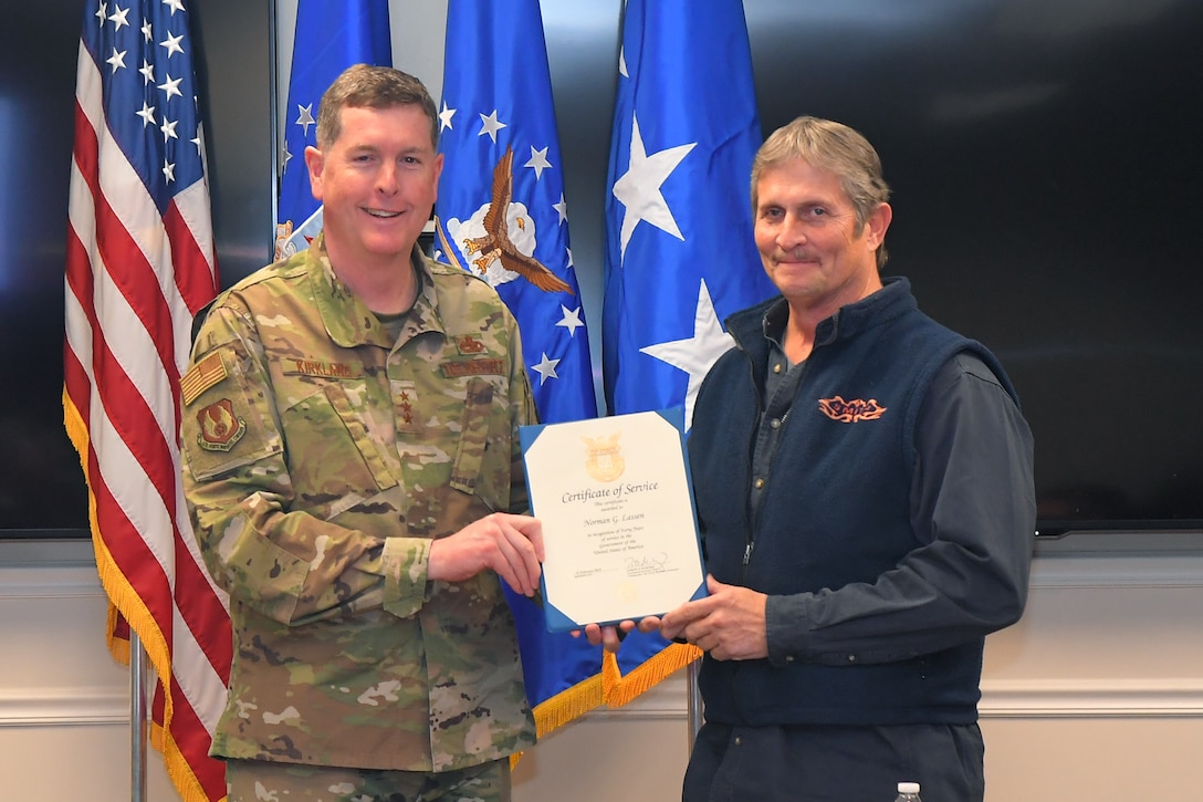Norman G. Lassen, 581st Missile Maintenance Squadron, receives a 40-year certificate of service from Lt. Gen Gene Kirkland, Air Force Sustainment Center commander, Feb. 4, 2019, at Hill Air Force Base, Utah. (U.S. Air Force photo by Todd Cromar)