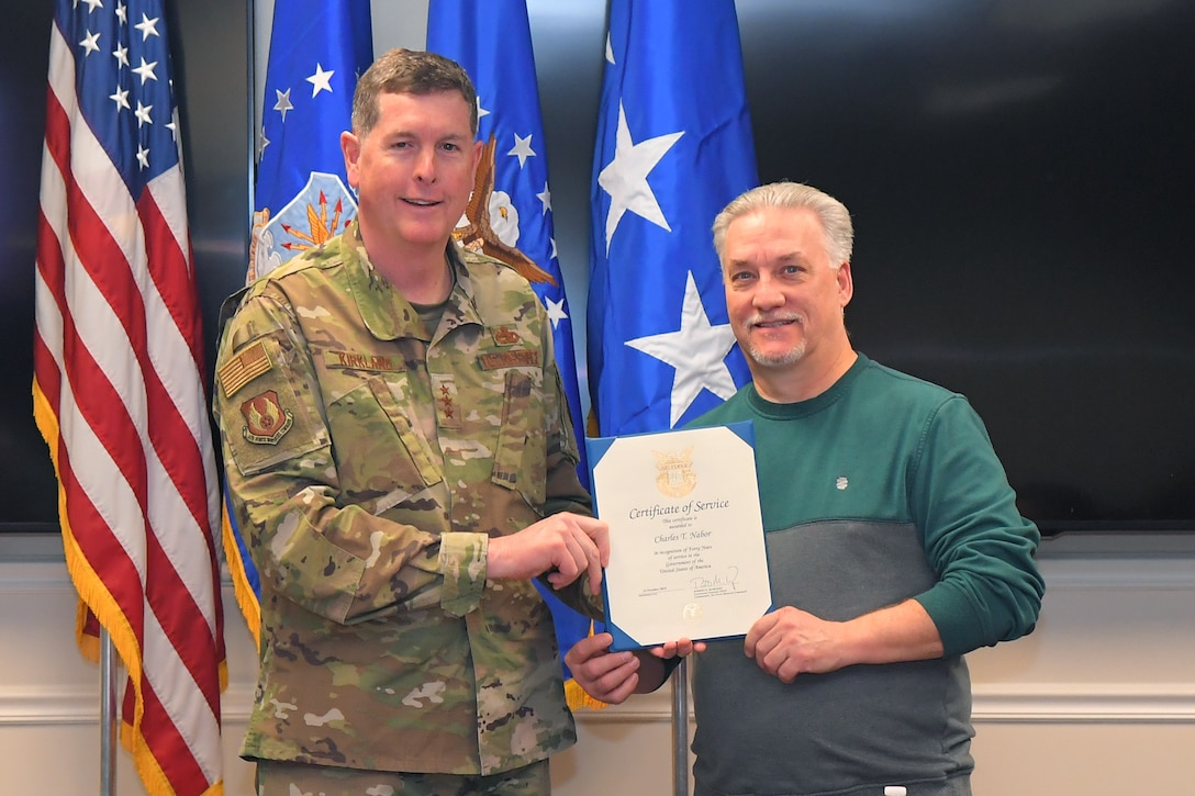 Charles T. Nabor, 524th Electronic Maintenance Squadron, receives a 40-year certificate of service from Lt. Gen Gene Kirkland, Air Force Sustainment Center commander, Feb. 4, 2019, at Hill Air Force Base, Utah. (U.S. Air Force photo by Todd Cromar)