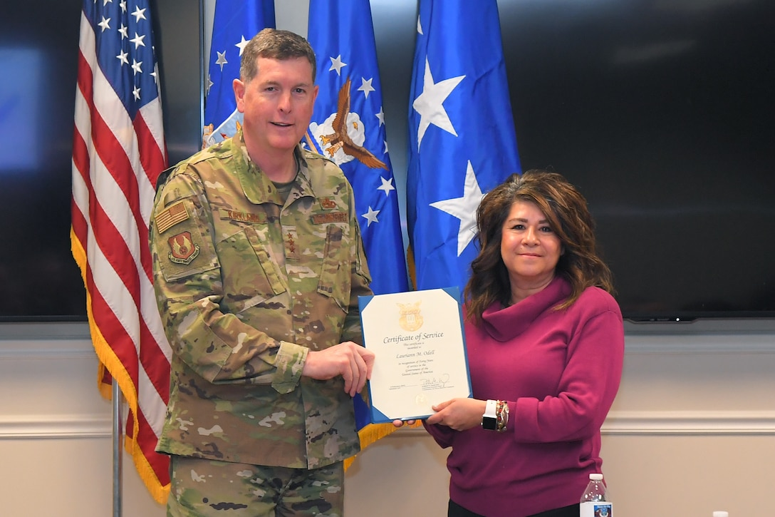 Lauriann M O'dell, Ogden Air Logistics Complex Business Office, receives a 40-year certificate of service from Lt. Gen Gene Kirkland, Air Force Sustainment Center commander, Feb. 4, 2019, at Hill Air Force Base, Utah. (U.S. Air Force photo by Todd Cromar)