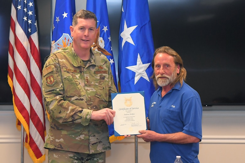 Andrew Perkins, 582nd Missile Maintenance Squadron, receives a 40-year certificate of service from Lt. Gen Gene Kirkland, Air Force Sustainment Center commander, Feb. 4, 2019, at Hill Air Force Base, Utah. (U.S. Air Force photo by Todd Cromar)