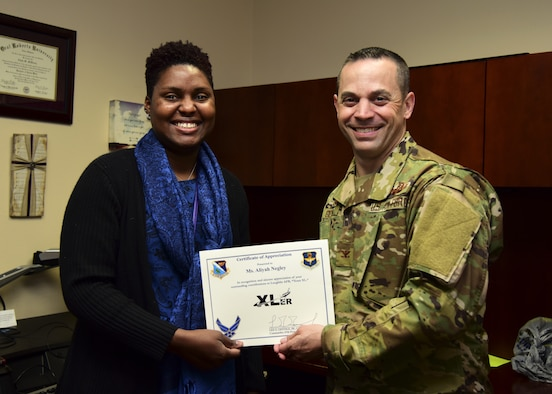 "Aliyah Negley, 47th Flying Training Wing community support coordinator, was chosen by wing leadership to be the ""XLer of the Week"", for the week of Feb. 7, 2019, at Laughlin Air Force Base, Texas. The ""XLer"" award, presented by Col. Lee Gentile, 47th FTW commander, is given to those who consistently make outstanding contributions to their unit and the Laughlin mission. (U.S. Air Force photo by Airman 1st Class Anne McCready)"