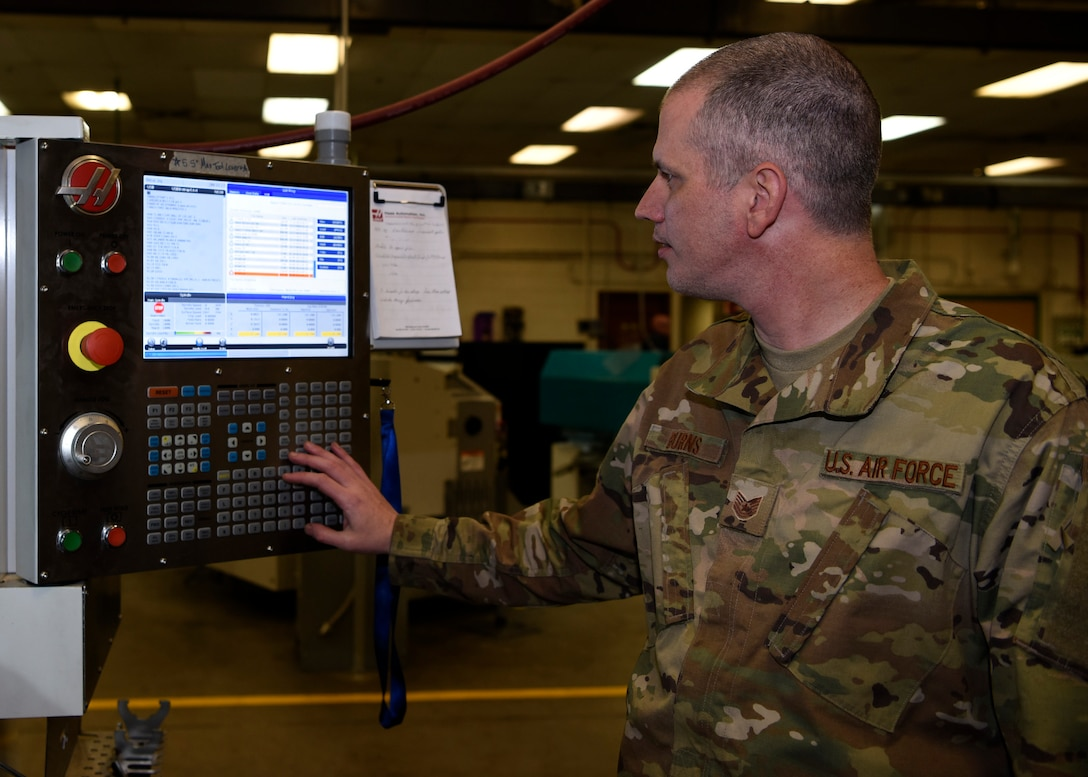 Tech Sgt. Robert Burns, 56th Equipment Maintenance Squadron aircraft metals technology non-commissioned officer in charge, inputs a command into a 5-axis computer numerical control machine, Feb. 6, 2019 at Luke Air Force Base, Ariz.