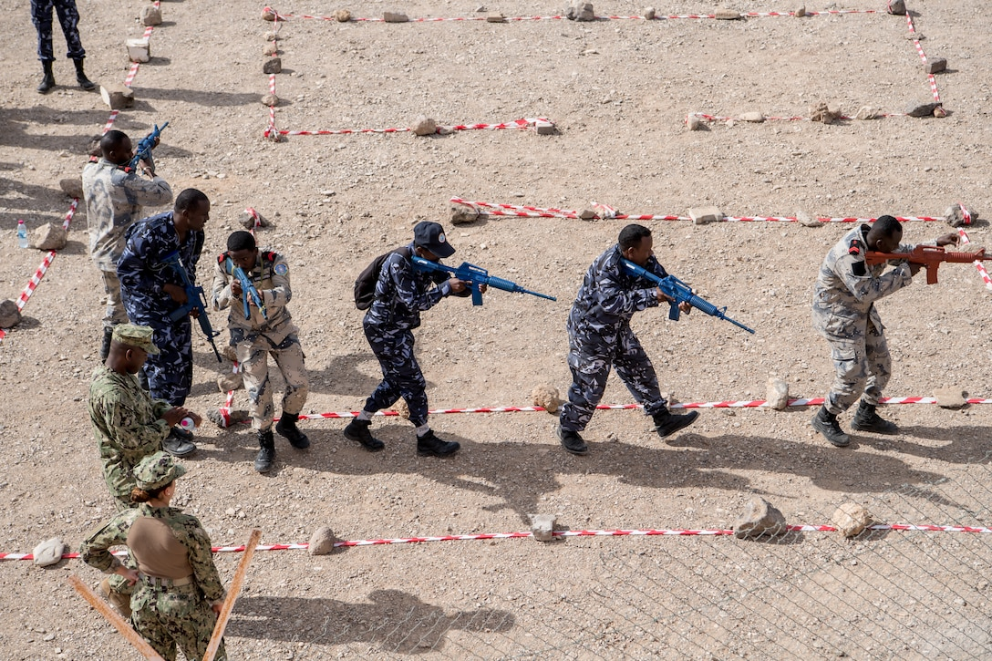 Sailors and Coast Guardsmen from around the globe participate in a simulated visit, board, search, and seizure exercise during Cutlass Express 2019 in Djibouti.
