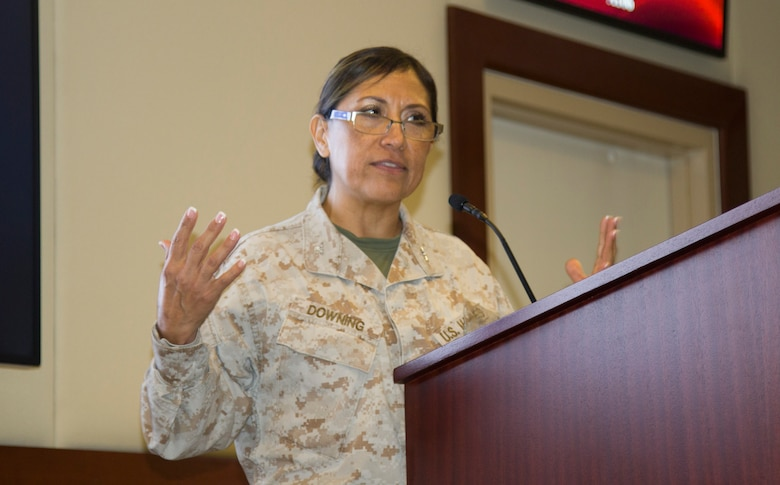 U.S. Marine Corps Col. Lina Downing, director of the Financial Management Division for Central Command, speaks to a crowd of finance and comptroller senior leaders during the U.S. Army Central Financial Management and Comptroller Forum at Al Udeid Air Base, Qatar, Dec. 3, 2018. Downing's team provides financial/fiscal guidance to U.S. ARCENT'S area of responsibility.