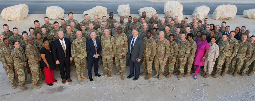 Personnel from the U.S. Air Force, U.S. Army, U.S. Marine Corps, Department of the Army, and Defense Finance and Accounting Service, pose for a group photo during the U.S. Army Central Financial Management and Comptroller Forum at Al Udeid Air Base, Qatar, Dec. 4, 2018. The forum provided an opportunity for leaders to meet and discuss ways to better use military resources.