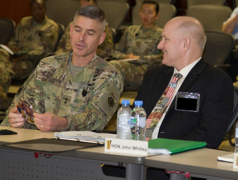 U.S. Army Maj. Gen. Brad K. Dreyer, the U.S. Army Central Finance Management assistant chief of staff, presents a token of appreciation to the Honorable John E. Whitley, the Assistant Secretary of the Army for Financial Management and Comptroller, during the U.S. ARCENT Financial Management and Comptroller Forum at Al Udeid Air Base, Qatar, Dec. 3, 2018. This was Whitley's first time in attendance at the annual forum and plans to use this opportunity to improve theater-wide financial decisions.