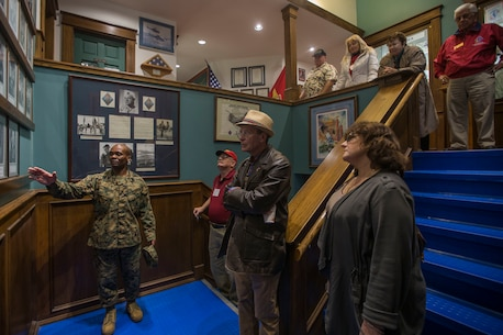U.S. Marine Corps Sgt. Maj. Terrence C. Whitcomb, the sergeant major of 1st Marine Division (MARDIV), gives a tour of the unit's Headquarters Building to Division veterans during the week of the 1st MARDIV 78th anniversary at Marine Corps Base Camp Pendleton, California, Feb. 1, 2019.