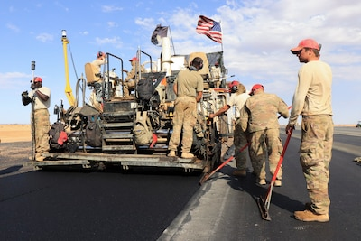 Airmen assigned to the 31st Expeditionary Red Horse Squadron, pave a flight line in Niger.