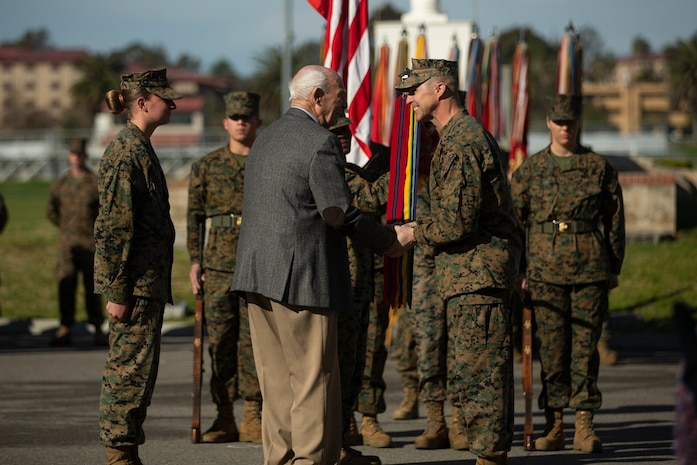 U.S. Marine Corps Maj. Gen. Robert F. Castellvi, the commanding general of 1st Marine Division (MARDIV), shakes hands with a veteran of the division during the 1st MARDIV 78th Anniversary Ceremony at Marine Corps Base Camp Pendleton, California, Feb. 1, 2018