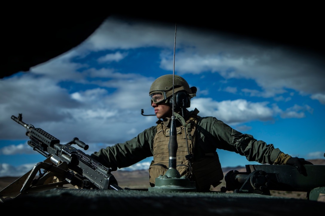 A Marine riding in a vehicle