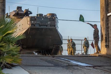 A U.S. Marine gives the Japan Ground Self-Defense Force Soldiers with 1st Amphibious Rapid Deployment Regiment, the go ahead for the assault amphibious vehicles to enter the water and travel to the USS Somerset (LPD 25) during Iron Fist 2019, Jan. 30 on U.S. Marine Corps Base Camp Pendleton, CA.