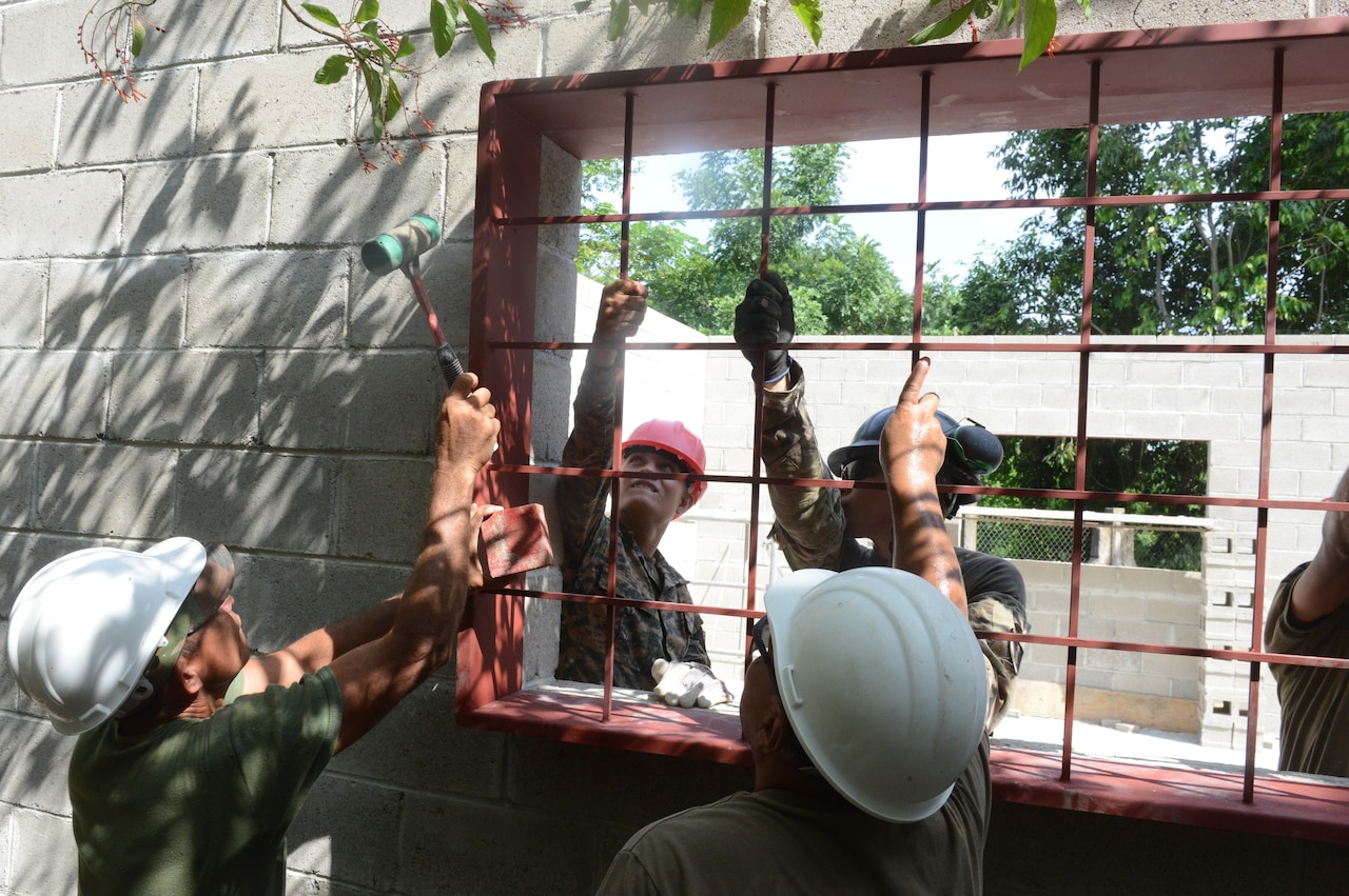 Troops install window frame