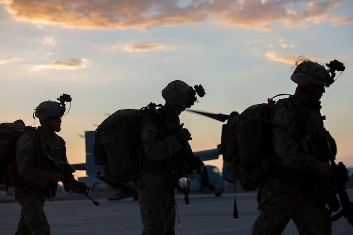 U.S. Marines with 2nd Battalion, 4th Marines walk to the MV-22 Osprey during Summer Fury at Naval Air Facility El Centro, Calif., Aug. 4, 2017.
