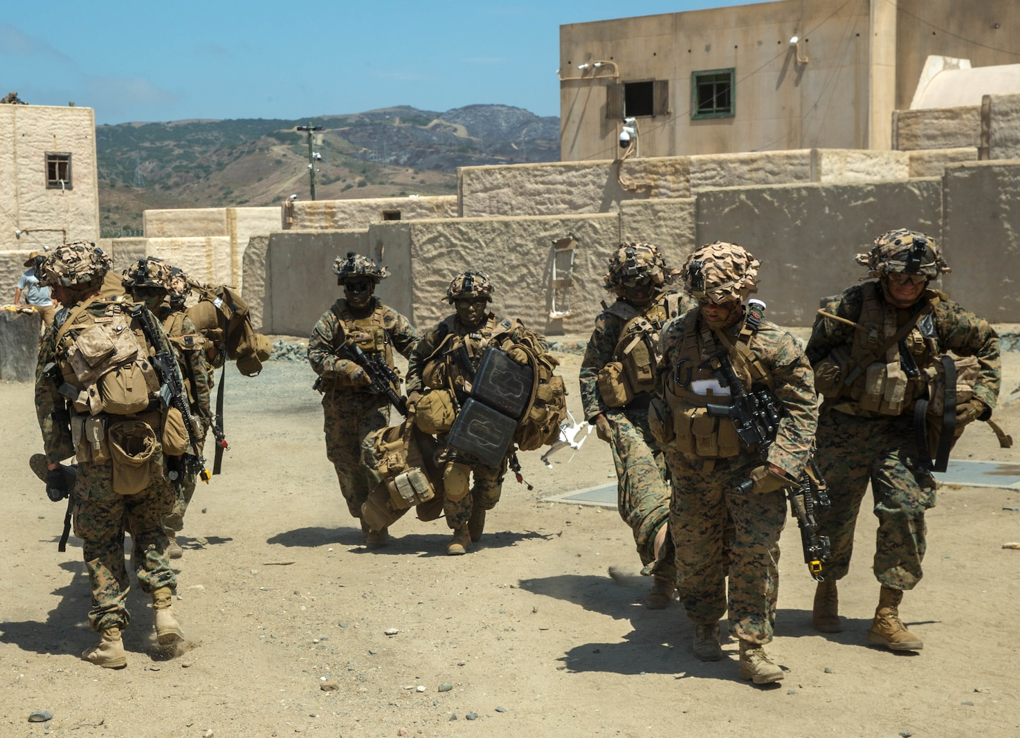 U.S. Marines with Echo Company, 2nd Battalion, 4th Marine Regiment, 1st Marine Division, carry injured Marines to the casualty collection point during Prime Time Training, at the Infantry Immersion Trainer (IIT) facility, Marine Corps Base Camp Pendleton, Calif., July 23, 2017.
